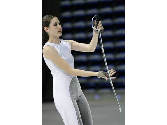Sarah Eagan, a member of the Valencia Color Guard team, practices for the Winter Guard International World Championship this April.