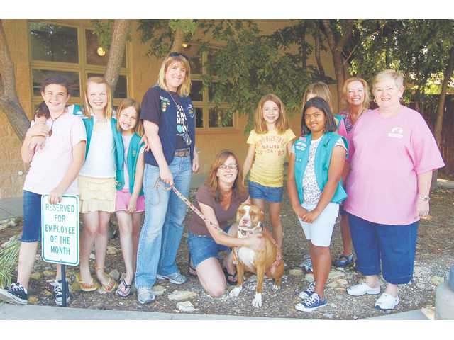 Loren, Michelle Sathe (kneeling center) and Girl Scout Troop 1604 with volunteers from Operation Kindness, who were very grateful for the $500 worth of donations to the no-kill facility in Carrollton, Texas.