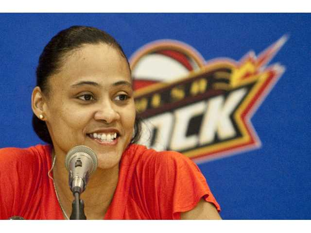 "Former sprinter Marion Jones smiles as she addresses the media during a news conference announcing her signing with WNBA basketball Tulsa Shock on Wednesday, March 10, 2010, in Tulsa, Okla. Jones was a star at the 2000 Sydney Olympics but admitted two years ago that she had taken the ""clear."" She was stripped of her medals, including three golds."