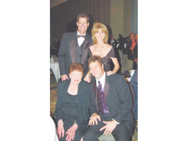 Dale and Tamara Donohoe, the 2009 Sweetheart Couple of the 'Have a Heart' Sweetheart Gala, standing, pose with event sponsor Roberta G. Veloz, seated at left, and her son, Peter Veloz.