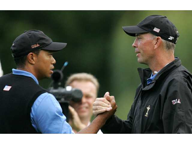 FILE - In this Sept. 23, 2006, file photo, Tiger Woods, left, shakes hands with United States team captain Tom Lehman at the end of the foursomes match against Europe's Padraig Harrington and Paul McGinley during the Ryder Cup in Straffan, Ireland. Television viewership will fall without Woods, but the networks that air the sport and the PGA Tour itself can handle the setback. That's the word from several media analysts and the president of CBS Sports, which now is facing the possibility of covering the Masters Tournament just weeks from now with golf's biggest star conspicuously absent.