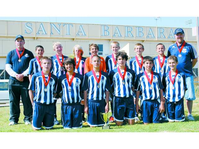 The Saugus Titans boys-under-14 AYSO soccer squad, with their second place Splash medals, include (kneeling in front row, left to right) Garrett Snyder, Anders Jansson, Ryan Mahoney, Zack Nua, Brett Schreiber, & Paulo Trentini. (Standing, left to right) coach Steve Singer, Michael St. Amand, Austin Reilly,  Aidan Mahoney, Justin Socarras, Josh Singer, Chris MacDonald, Joseph Cox and  coach John  Cox (not pictured Michael Fishbach).