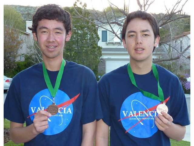 "Ryan and Kevin Casey brought home medals in ""Remote Sensing"" for the team."
