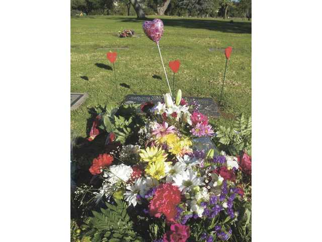 The grave of Ritchie Valens is piled high with flowers.