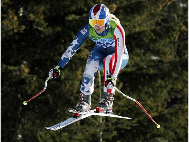 Lindsey Vonn of the United States is airborne during the Women's downhill, at the Vancouver 2010 Olympics in Whistler, British Columbia, Wednesday, Feb. 17, 2010.