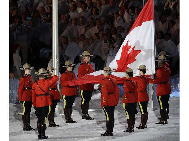 The Canadian flag is raised during the closing ceremony for the Vancouver 2010 Olympics in Vancouver, British Columbia, Sunday, Feb. 28, 2010.