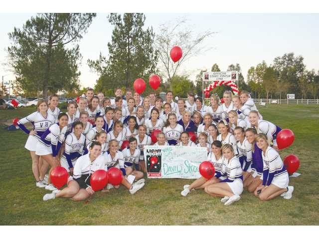 The Valencia High School Vikings Cheer Squad gathered for a team photo before the start of the Leukemia & Lymphoma Soceity's Light the Night Walk held Sunday at Bridgeport Park in Valencia. The squad turned out to cheer on walkers and in support of classmate David Stroud, diagnosed in April with Lymphoma.