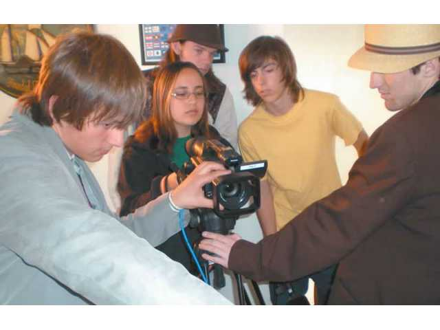 Golden Valley High students filming on location for their project. From left are Stephen Bevilacqua, Khrystina Lund, Shane Phillips, Brad Bennett and Sean Keefe.