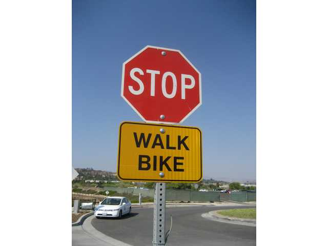 "A closeup of the new cautionary ""WALK BIKE"" signs posted at intersections throughout Santa Clarita as a part of the city's Non-Motorized Transportation Plan."