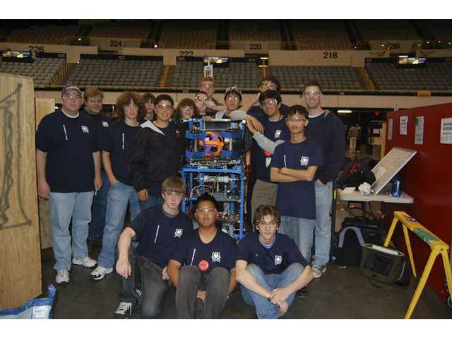 Robotics team members and mentors front from left to right: Nathan Kish, Marcus Kwak, Brandon Bussjaeger. Back from left to right: Dennis Smalley, Rich Petras, Andy Bax, Garret Smalley, Ali El-Arabi, Tommy Peterson, Brandon Robbins, Richard Petras, Brian Lee, Patrick Allen, Anish Sawant, Choongil Lee, Gary Haggart.
