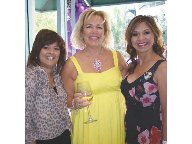 Rose Chegwin, left, co-chairwoman of The Wine Affair, Kris Hough, of SCV Bank and Dora Zavala, president of Soroptimist International of Greater Santa Clarita Valley, greeted guests at the VIP Vault Tasting held at SCV Bank.
