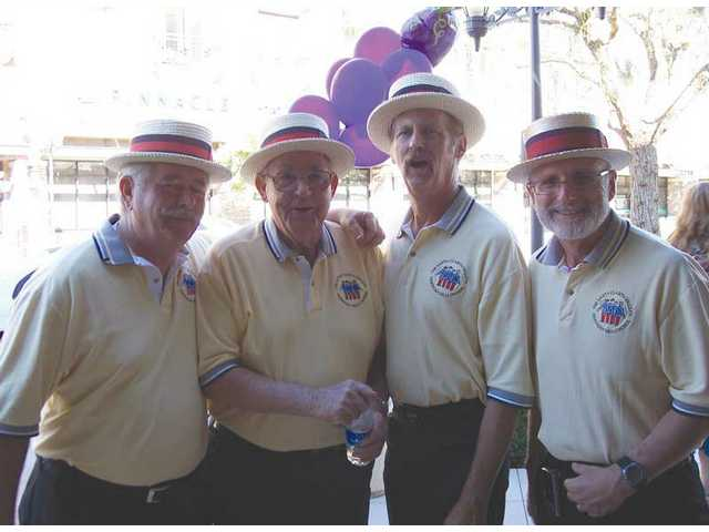 Men of Harmony, a barbershop quartet, entertained at Lee's Wine Bistro on Town Center Drive.
