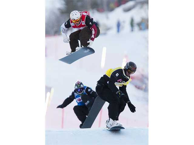 In this Jan. 21, 2010 photo, Pierre Vaultier, of France, right, makes his way to gold as he's followed by Graham Watanabe, top, of the United States, who took silver, and Shaun Palmer of the United States, follows for bronze in the FIS World Cup Snowboard Cross finals in Stoneham, Quebec.