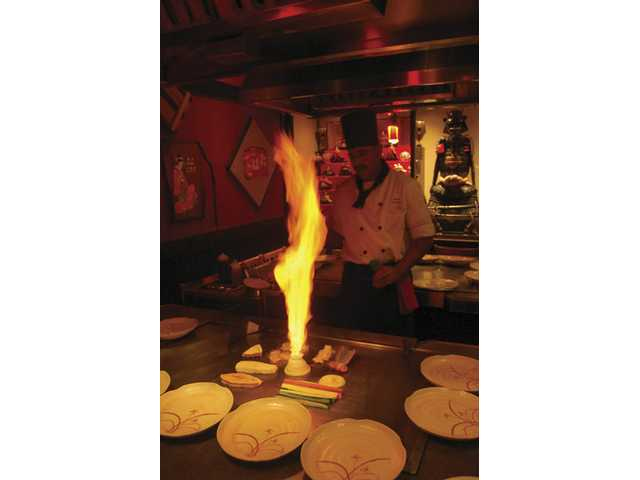 "Yamato teppan yaki chef Hector Arriaga stands back from the ""volcano,"" a stack of onion slices he lights on fire, to the delight of dining audiences."