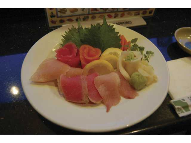 A chef's assortment sashimi plate at Yamato included salmon, tuna, yellowtail, seared tuna, albacore, and whitefish.