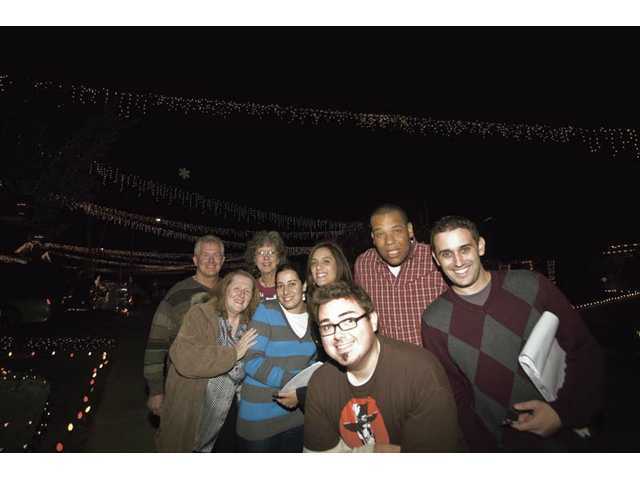 The judges for the 16th annual Holiday Light Tour, from left, Jim Walker, Michele Buttelman, Lila Littlejohn, Tammy Marashlian, Melissa Gasca, Josh Premako, Brian Charles and Brandon Lowrey. Newcomers and old hands had a great time viewing the impressive holiday displays and mingling with the true fans of the season, the entrants in the Signal Holiday Light Tour. Of course, the many bribes of swag and sweets and food and libation didn't hurt. Here the crew seems to be peaking on a chocolate high.