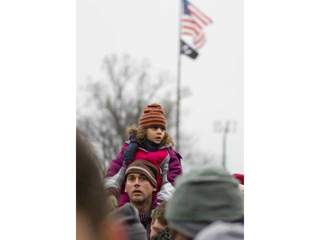 A father and his daughter make their way through a crowd of 500,000 people attending Sunday's concert in Washington, D.C.