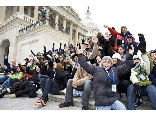 Students like these taking a break in Washington, D.C., Monday were there from around the United States to witness Tuesday's civics lesson of the lifetime at the inauguration of President-elect Obama.