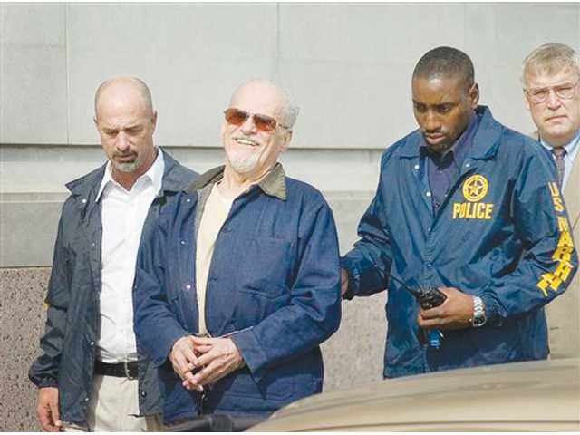 Tony Alamo is walked from the courthouse in downtown Texarkana, Ark. on Friday, shortly after he received a maximum sentence of 175 years in a federal prison.