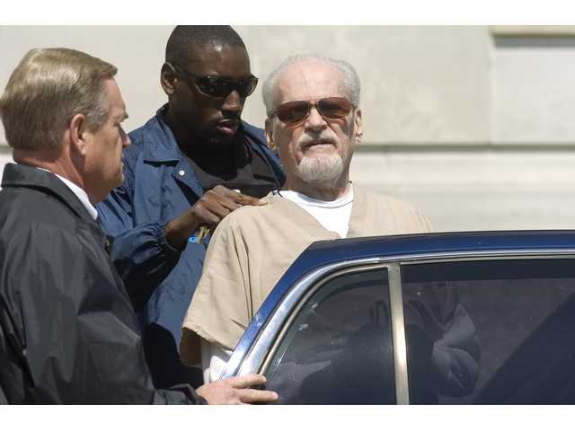 Evangelist Tony Alamo is led from the federal courthouse in downtown Texarkana, Ark., Friday, July 24, 2009. Alamo, a one-time street preacher who built a multimillion-dollar ministry and became an outfitter of the stars, was convicted Friday of taking girls as young as 9 across state lines for sex.