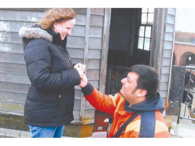 Reuben Edward Marquez, right, proposes to Jennifer E. Balogh at the Golden Gate Bridge.