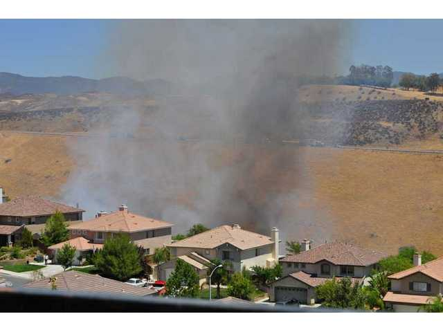 Smoke billows from a brush fire in Castaic Thursday.