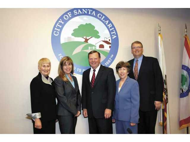 The new City Council poses for a photograph. From left are Laurene Weste, Laurie Ender, Bob Kellar, Marsha McLean and Frank Ferry.