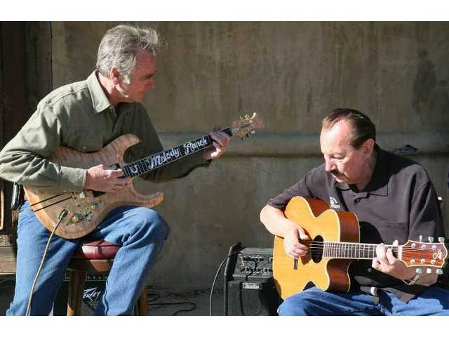Melody Ranch co-owner Renaud Veluzat plays rhythmic foil to legendary Ventures guitarist Nokie Edwards' lead runs during the second of half a dozen special performances at the Ranch Saturday and Sunday.