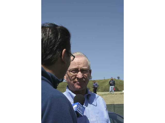 "Evan Thomasson of the city of Santa Clarita interviews Congressman Howard P. ""Buck"" McKeon (R-Santa Clarita) during the cross-valley connector bridge opening on Saturday."