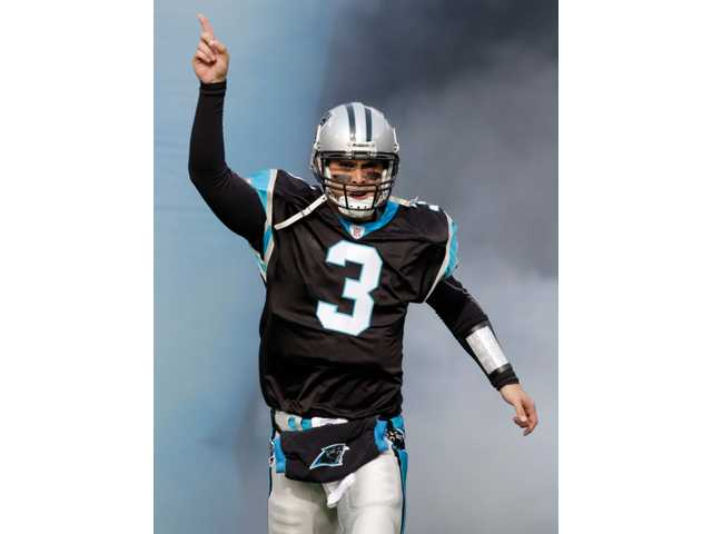 Carolina Panthers quarterback and Hart High graduate Matt Moore (3) is introduced before an NFL football game against the Tampa Bay Buccaneers in Charlotte, N.C. on Dec. 6.