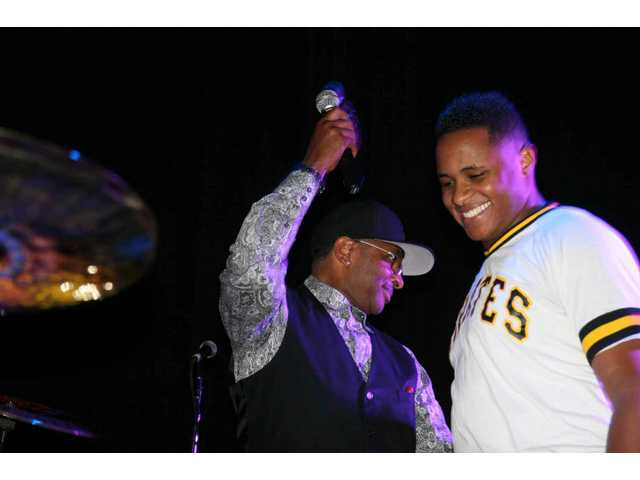 Ronald Bruner Sr. (left) introduces his son's band at the Pro Drum Shop 50th anniversary concert at the Avalon in Hollywood Satiurday.