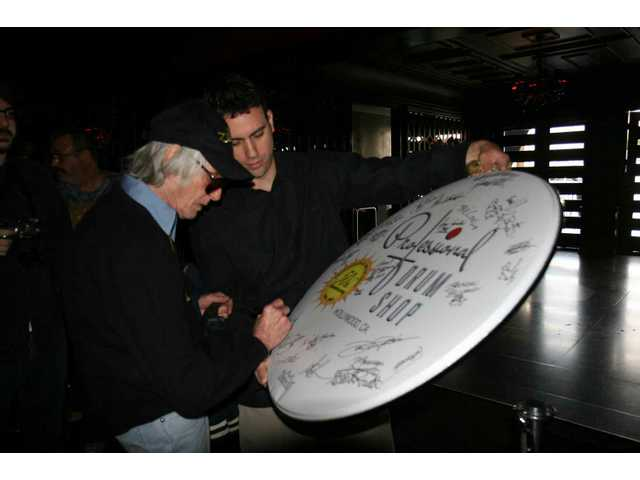 Drummer Freddie Gruber adds his name to the other all-stars signing a commemorative Pro Drum Shop 50th anniversary drumhead at the shop's party at the Avalon in Hollywood Saturday afternoon.