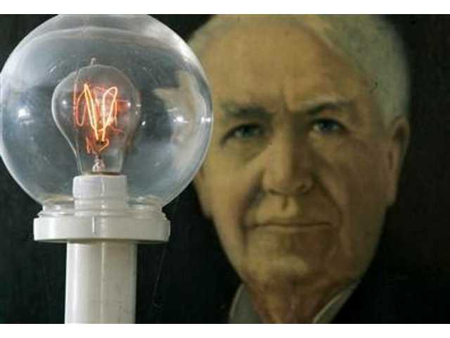 A model of an 1879 street light burns in the Edison Museum in Edison, N.J., in front of a portrait of inventor Thomas A. Edison, in this Feb. 7, 2007 photo. After more than a century, his incandescent lighting is giving way to more energy-efficient fluorescent lighting.