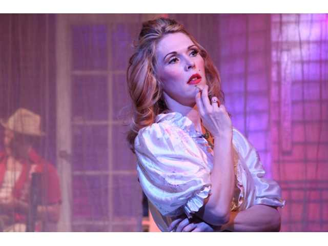 "Erin Michaels stars a Blanche du Bois in the Repertory East Theatre's production of ""A Streetcar Named Desire."""