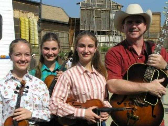 The Quebe Sisters Band -- Hulda, Sophia and Grace with guitarist/arranger Joey McKenzie -- are ready to roll on the Melody Ranch set at the 2006 Cowboy Festival.
