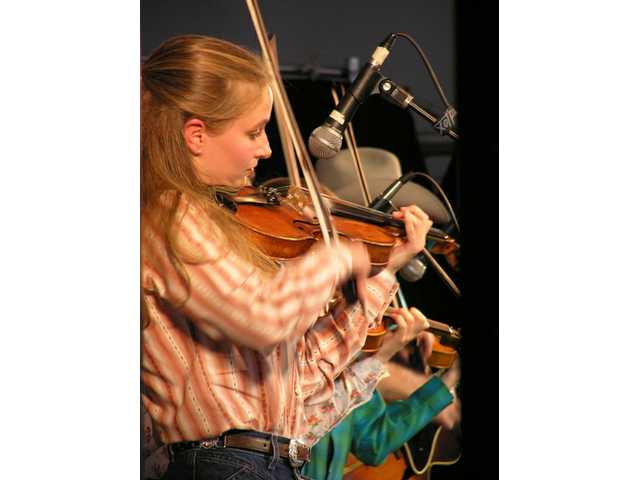 Sophia Quebe of the Quebe Sisters Band, on the Main Stage at Melody Ranch during the Santa Clarita Cowboy Festival, April 29, 2006, in her first public performance in Southern California.