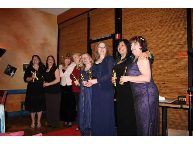 "The new officers of the Family Day Care Association of the Santa Clarita Valley clutch their ""Oscars"" during installation ceremonies held at Wolf Creek restaurant in Valencia."