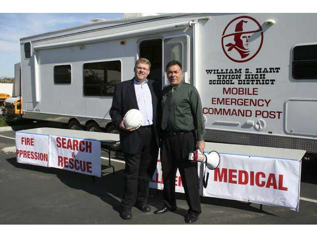 Santa Clarita's Mayor Frank Ferry and Placerita Junior High's Bob Weber stand in front of the Hart District's new emergency trailer.