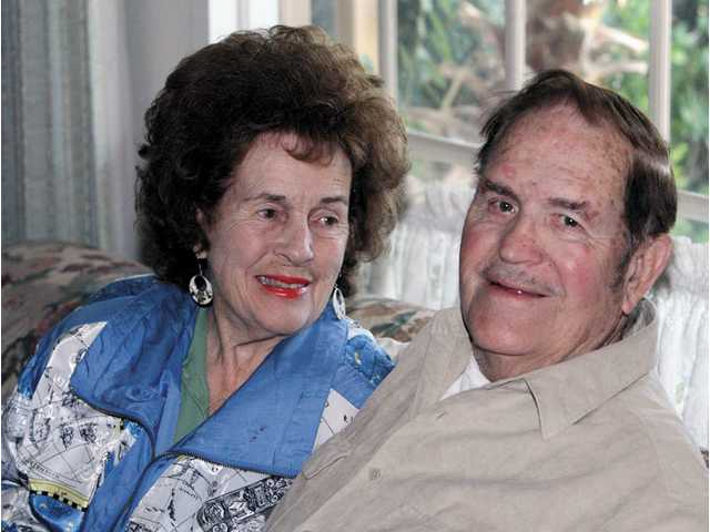 """Morris Deason and his wife Geri display his wall of memories and a proclamation naming him a """"Pioneer of the City of Santa Clarita"""" in his home in Saugus. The couple recently celebrated their 61st wedding anniversary and he is involved in the Library of Congress' Veterans History Project."""