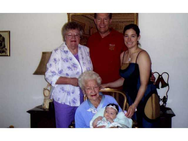 A baby girl born March 4, 2009, to Stefanie and Alex Smith of Valencia became a fifth generation Californian. Standing, left, great-grandmother Pat Tyler, grandfather Stan Tyler, mother Stefanie Tyler Smith, seated, great-great-grandmother Pat Dearing holds the newest member of the family, Tyler Smith.