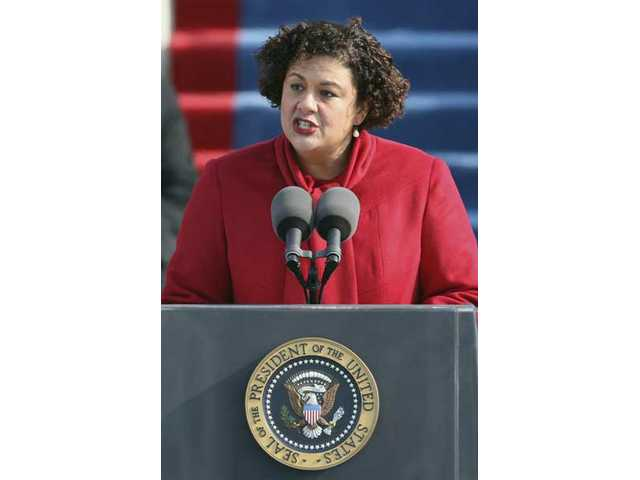Elizabeth Alexander recites a poem during swearing-in ceremonies at the U.S. Capitol in Washington, Tuesday, Jan. 20, 2009.