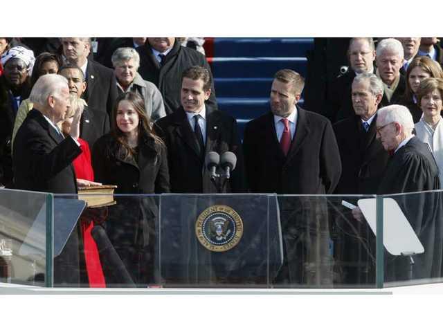 Joe Biden is sworn in as vice president by Justice John Paul Stevens at the U.S. Capitol in Washington, D.C., Tuesday, Jan. 20, 2009.