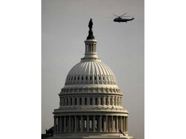 A Marine Corps helicopter carrying former President George W. Bush flies past the U.S. Capitol for the final time en route to Andrews Air Force Base following the presidential inauguration of Barack Obama on Tuesday, Jan. 20, 2009, in Washington, D.C.