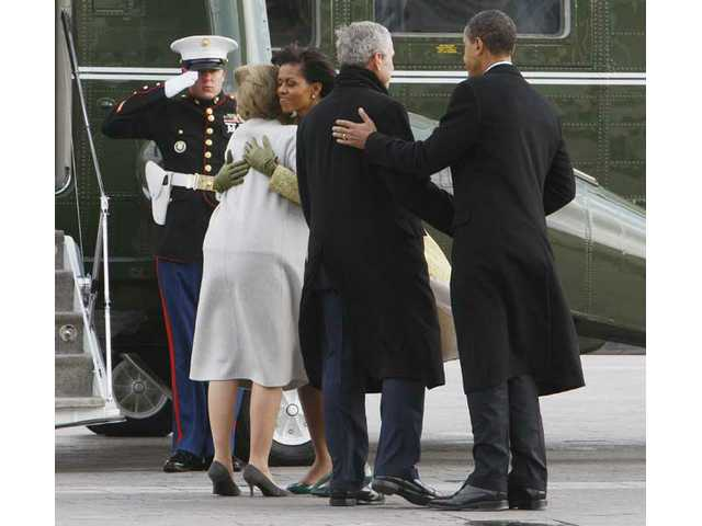 President Barack Obama and first lady Michelle Obama bid farewell to former President George W. Bush and Laura Bush at a waiting Marine helicopter on the East front of the Capitol in Washington, D.C.,after Obama was sworn in as the 44th president Tuesday, Jan. 20, 2009.