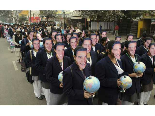 School children wear masks of U.S. President-elect Barack Obama as they take out a procession to mark his inauguration in Lucknow, India, Tuesday, Jan. 20, 2009.