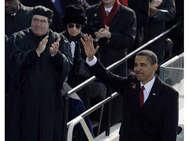 President Barack Obama waves after he delivered his inaugural address at the U.S. Capitol in Washington, D.C., Tuesday, Jan. 20, 2009.