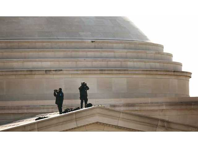 Members of the United States Secret Service use binoculars as they provide security during the presidential inauguration of Barack Obama, Tuesday, Jan. 20, 2009, in Washington, D.C.