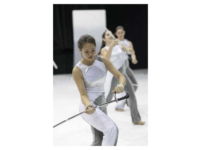 Katie Wong, a member of the Valencia Color Guard team, practices for the Winter Guard International World Championship this April.