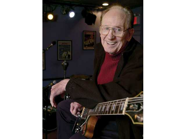 In this Oct. 4, 2004 file photo, guitar legend Les Paul gets ready to rehearse at the Iridium Jazz Club in New York. Paul, 94, the guitarist and inventor who changed the course of music with the electric guitar and multitrack recording and had a string of hits, died Thursday, Aug. 13, 2009 in White Plains, N.Y.
