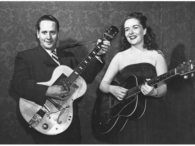 In this Nov. 5, 1951 file photo, Les Paul and his wife, Mary Ford, perform with their guitars. Paul, 94, the guitarist and inventor who changed the course of music with the electric guitar and multitrack recording and had a string of hits, died Thursday, Aug. 13, 2009 in White Plains, N.Y.
